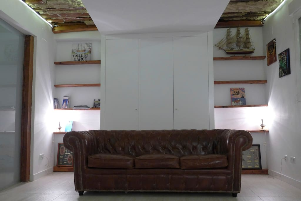 Chesterfield sofa and shelves