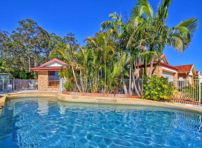 Sundrenched home with huge pool and bush backdrop!