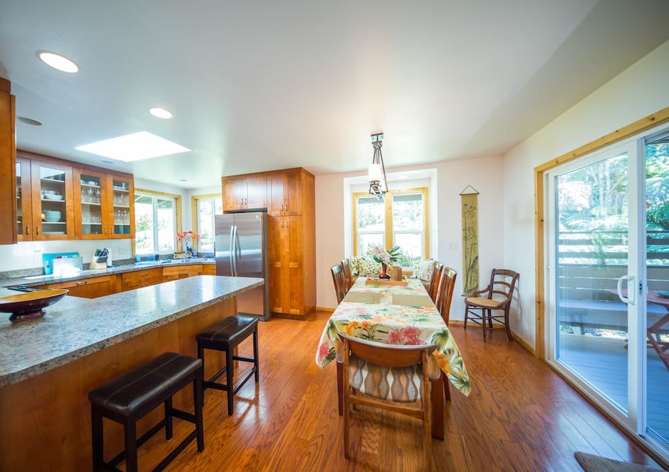 Dining table and reading nook right off the open kitchen with sliding doors leading to the covered deck.