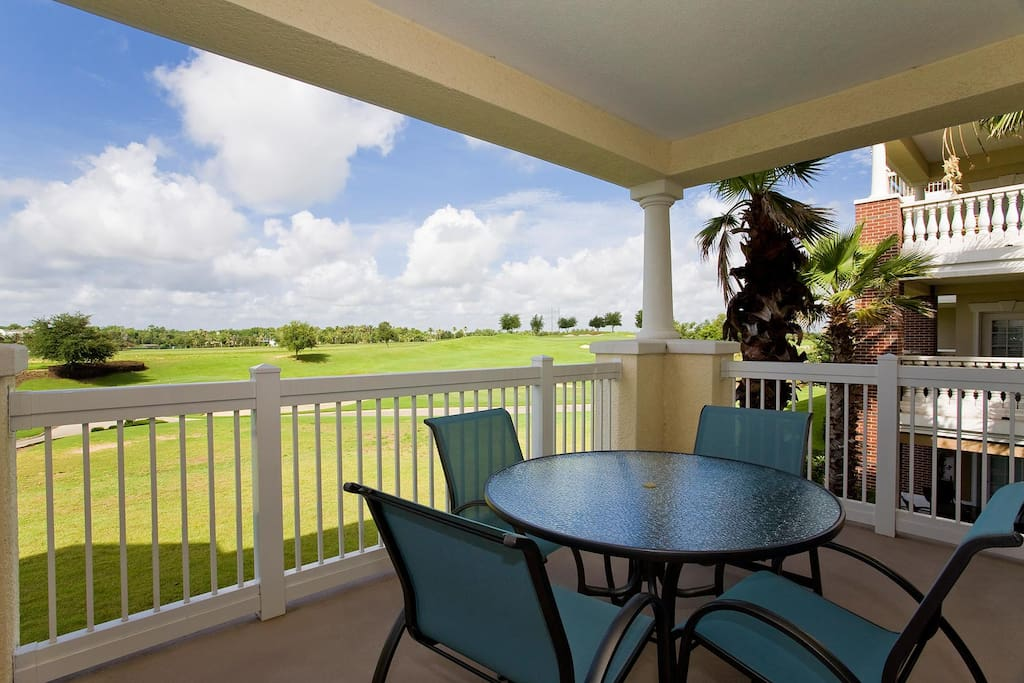 The patio balcony overlooks the 15th hole of the Watson Course in Reunion Resort