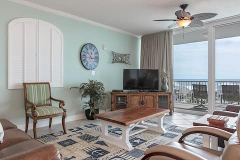 Beach condo overlooking the Gulf w/ shared pool, fitness room, & grilling area!