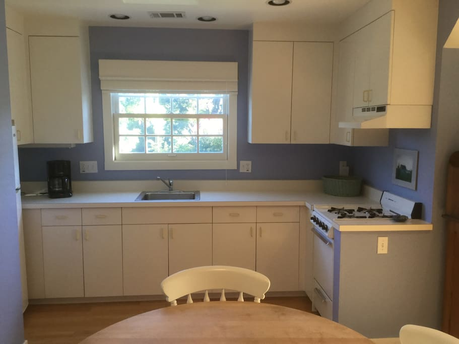 Kitchen with stove, refrigerator and microwave