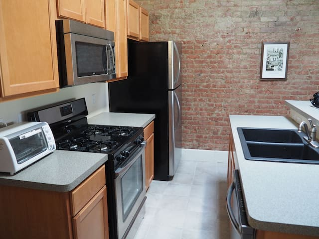 Open fully equipped kitchen.