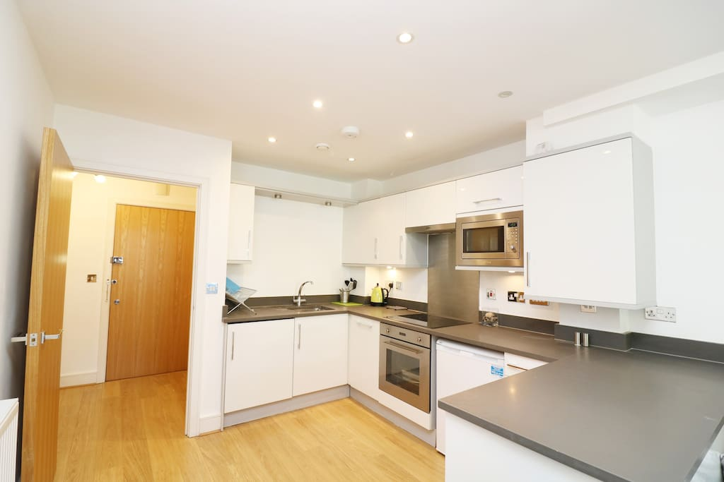 Fully fitted modern kitchen with 2 under the counter fridges