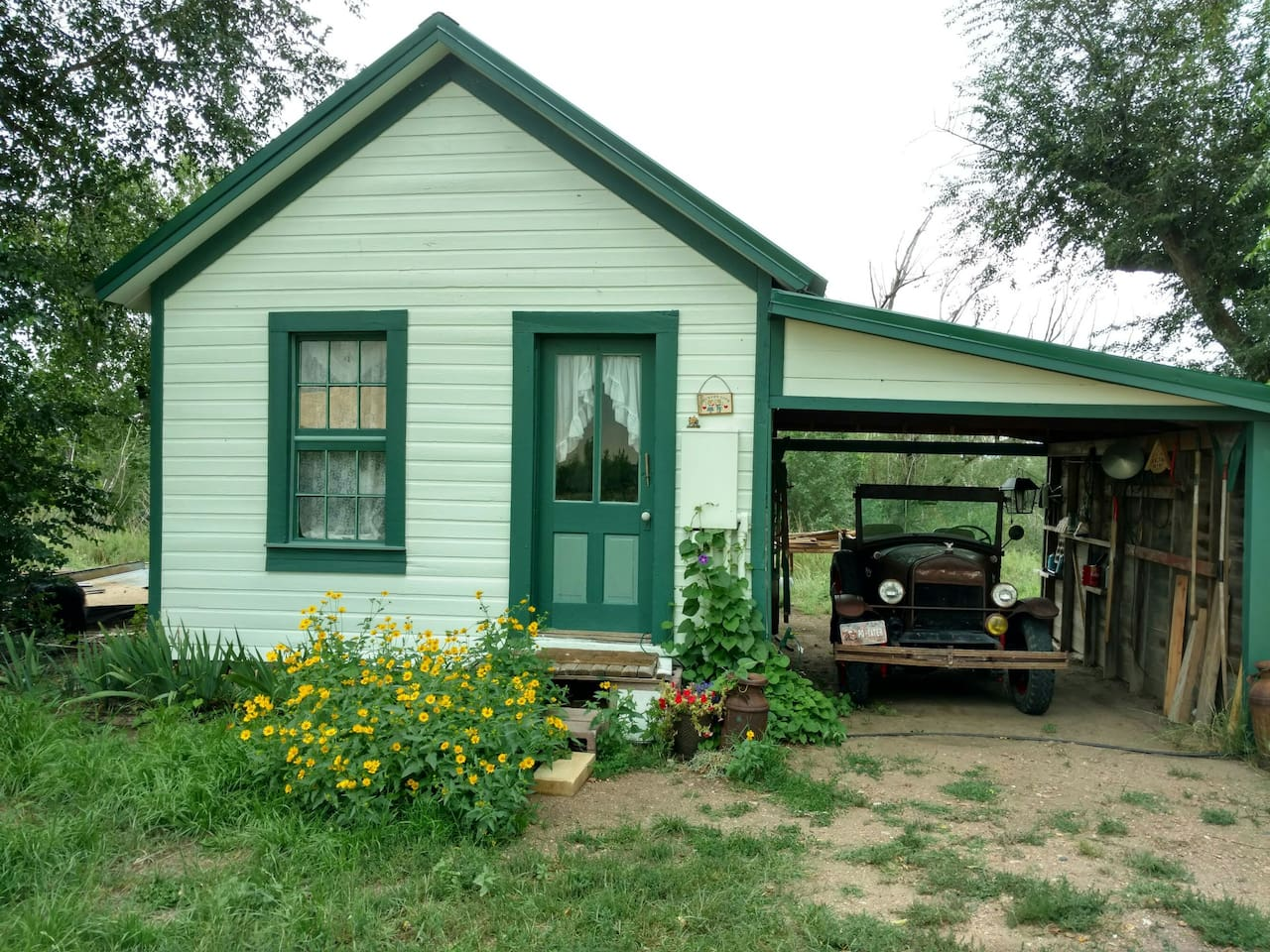 The 1914 Homestead Cottage ready for guest in August, 2016 when this photo was taken. Now it is ready for you and even more improved in spring of 2019 ! Thanks to guest and others making this rescue possible!  it is now freshly painted white & green