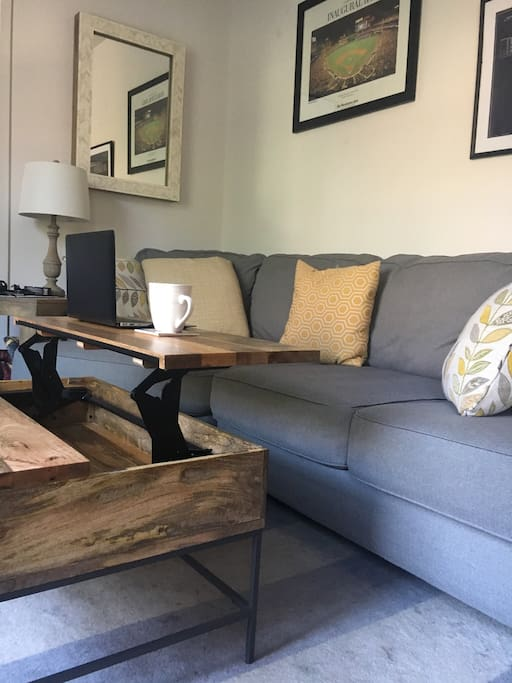 Coffee table expands into a desk making working from home comfortable and easy.