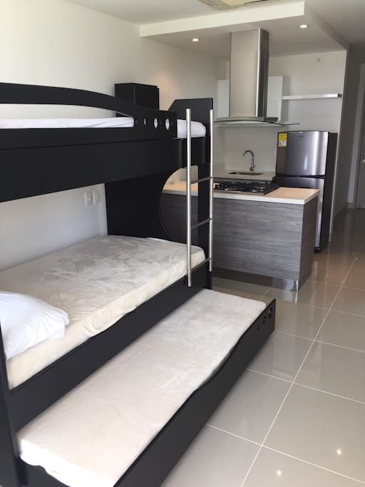 Bunk bed with additional bed pullout