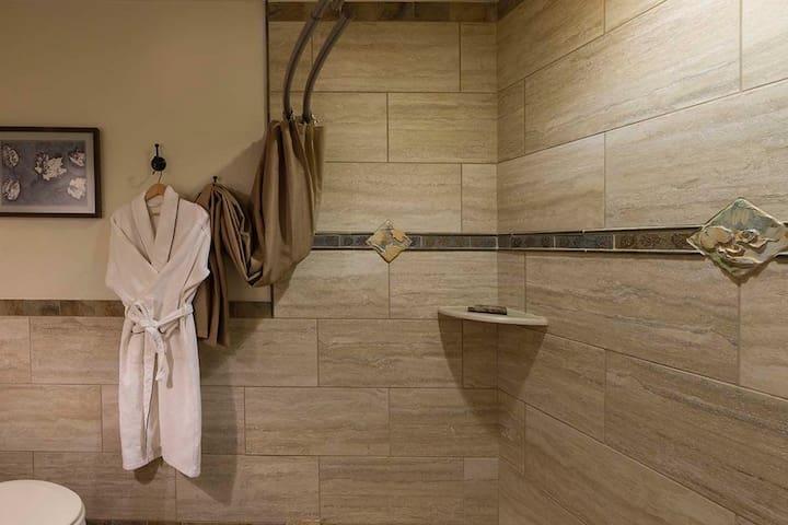 Custom tiled heated floor private bath