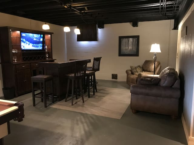 Bar with sitting area in basement