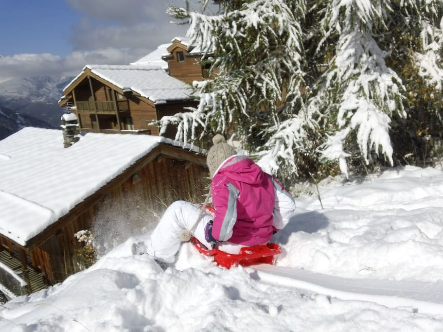 Sledging in the meadow behind chalet