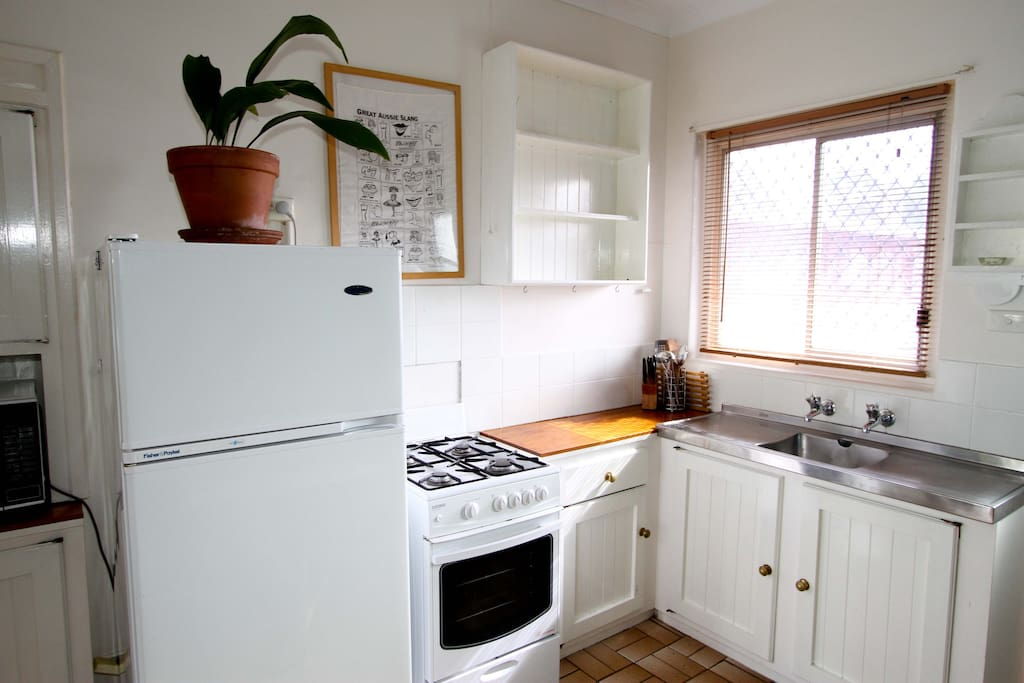 Fully equipped kitchen with big fridge, stove, microwave.