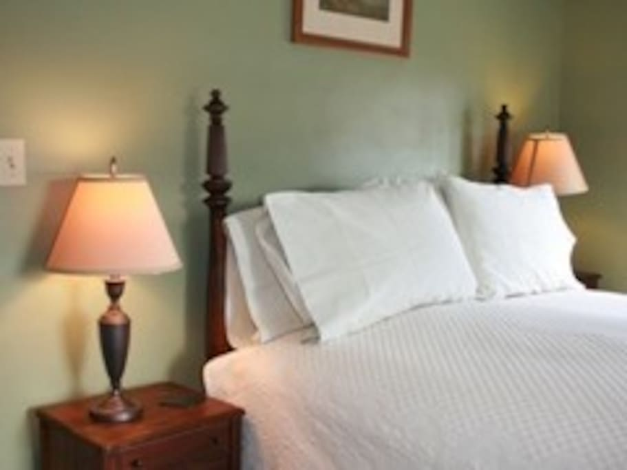 Relax and unwind in the Chittenden Room's comfortable featherbed
