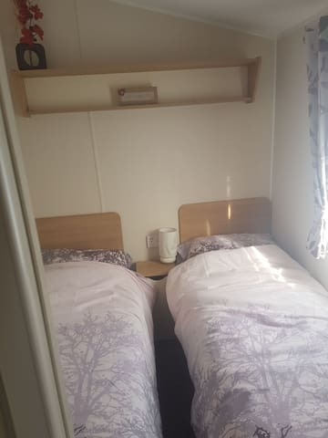1st bedroom with 2 single beds