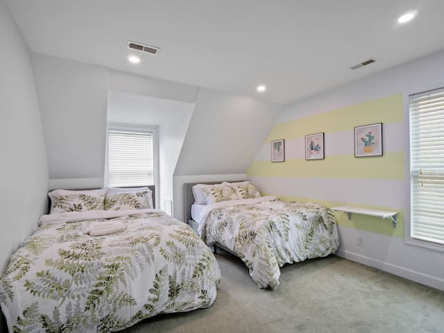 1 of 2 Upper Bedrooms:  2 Full/Queen memory foam beds in an earthy ambiance. Soft and firm pillows on bed for any guest.