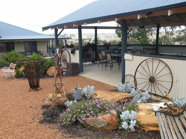 Fabulous pergola area with large bbq and outdoor settings, dart board and air hockey table