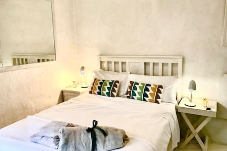 Charming small room with double bed and ensuite bathroom with shower. It opens onto a patio