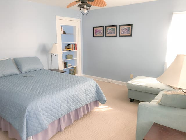 The room is spacious with a private entrance, it has a full bathroom with fixed accessibility bars next to toilet and shower, double walk-in closet