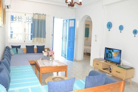 Wohnung mit Garten, 5 Minuten vom Strand
