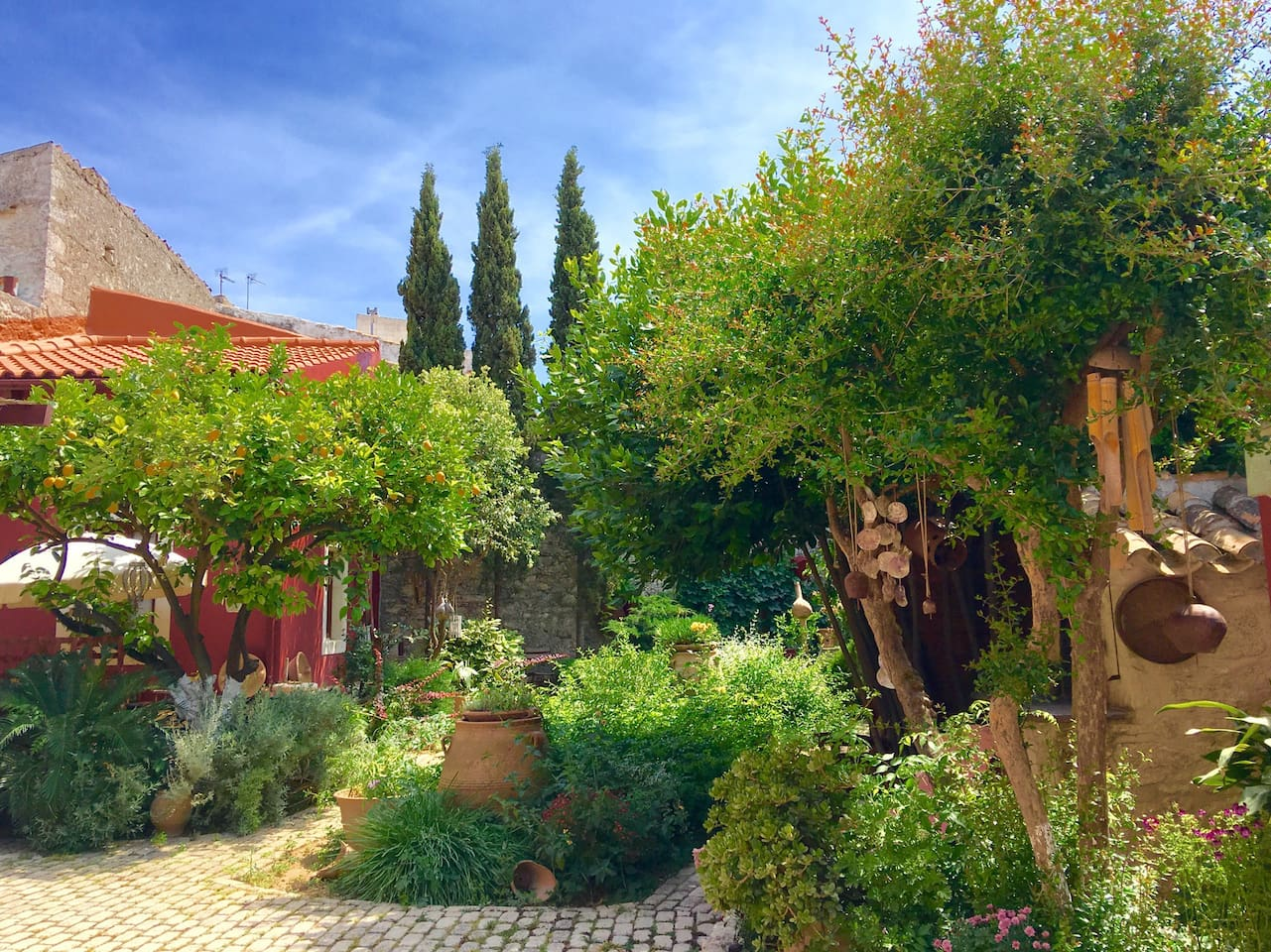 The Romantic Minoan Villa stands as a peaceful, tranquil and protected space, in the heart of a colorful aromatic garden designed by the Potter Helen Weisz.