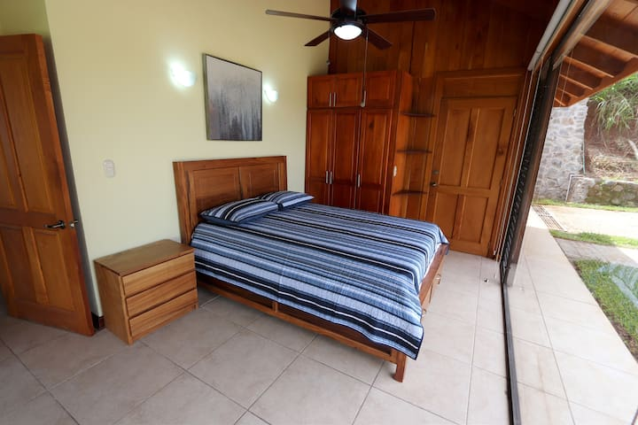 Bedroom #4 features a custom made queen bed fabricated by the artisans in Sarchi. The closets were built by an artisan in Atenas.