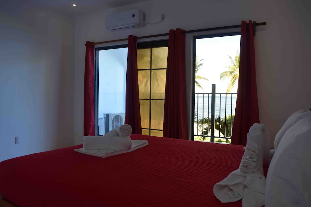Watch the sunrise in bed. Master bedroom with AC