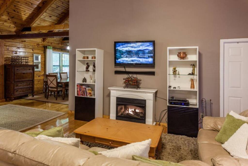 Great Room with a 42 inch flat screen TV and a gas fireplace