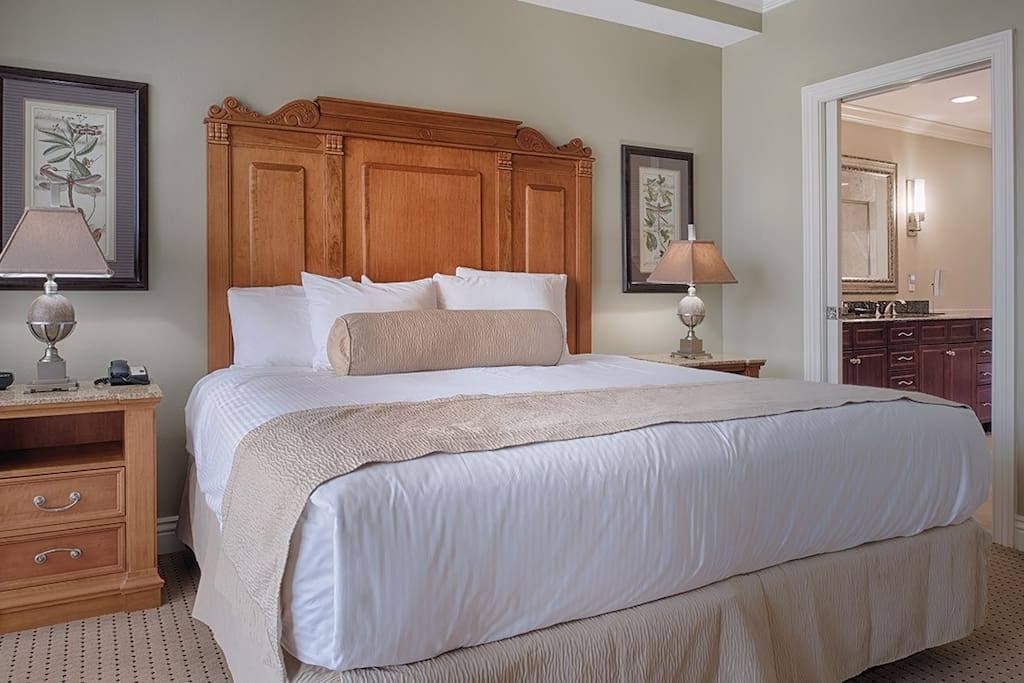 Master Bedroom with King Size Bed. Please note that layout and decor varies.