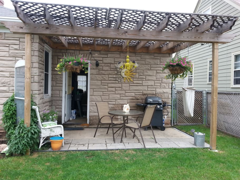 Outdoor patio with lighted pergola and gas grill to entertain.