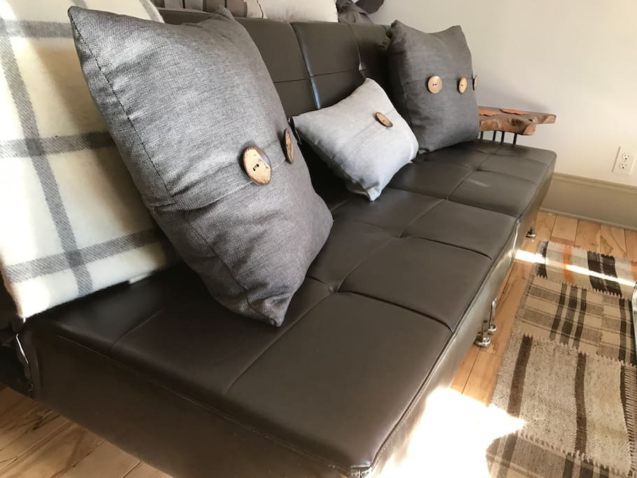 adjustable sofa with linen down pillows, wool throw from British Isles