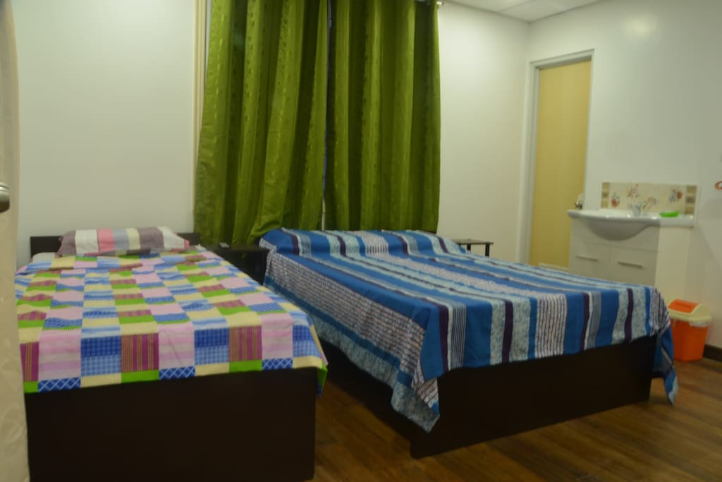 Room 3 - 2nd floor can accommodate 3 guests. 1 single bed, 1 double bed.