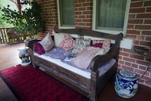 Day bed to relax on shaded cool veranda blankets provided for cooler evenings winter days.