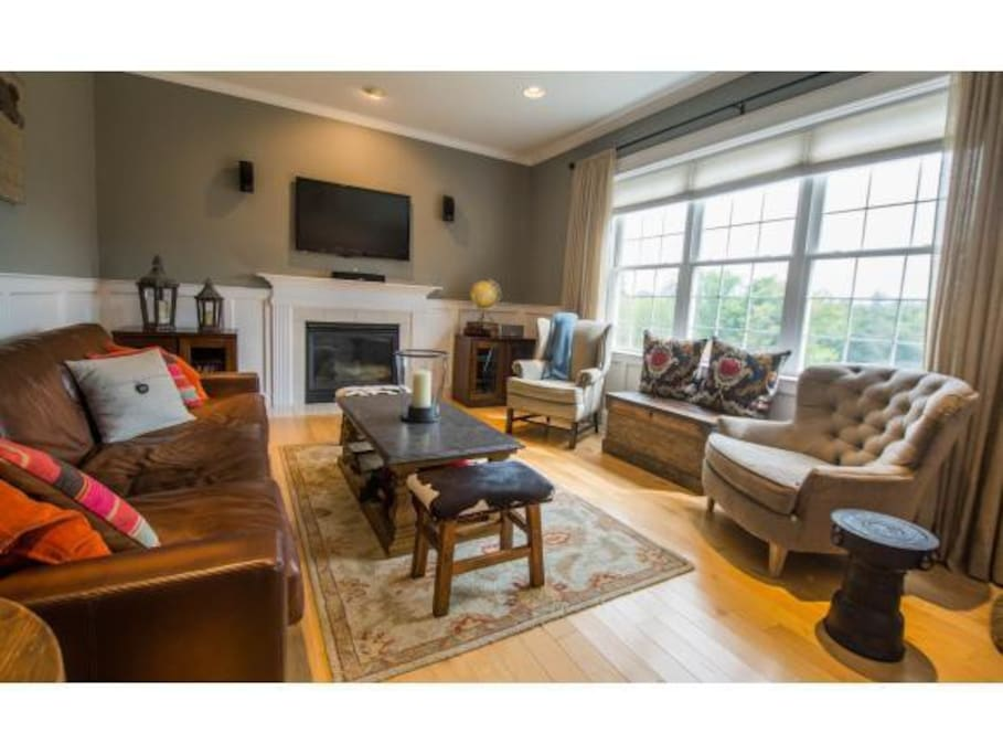 Bright family room with high end furniture.