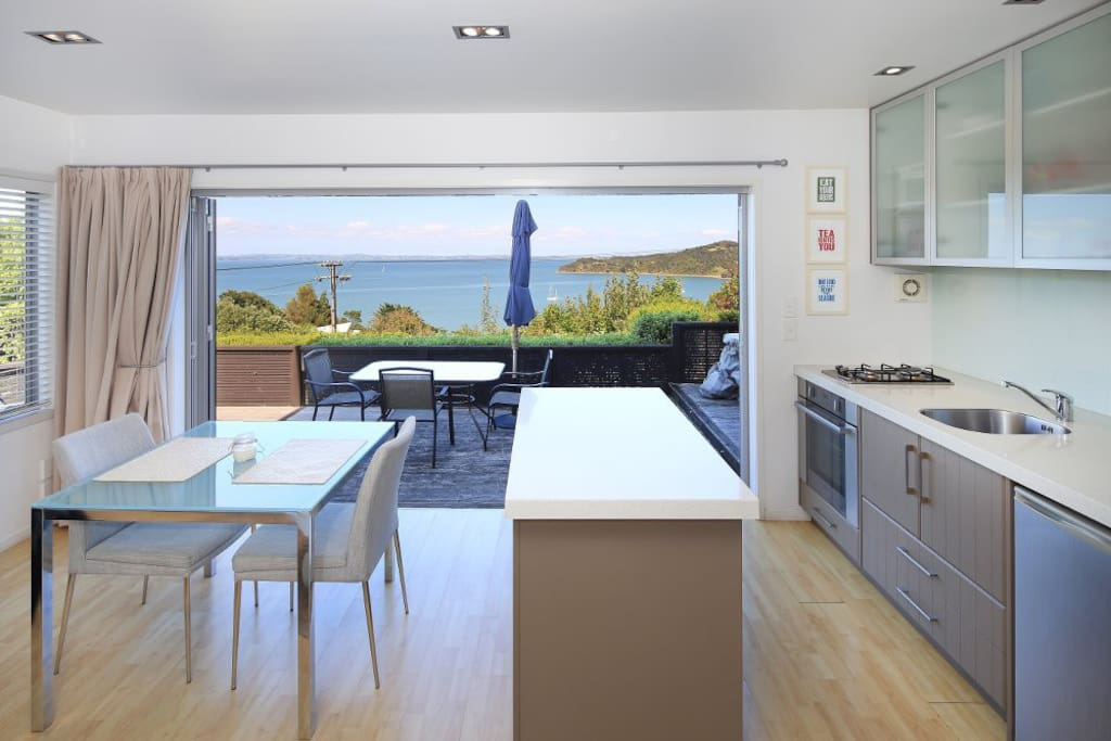 Another view out to the deck and sea from the open plan living and kitchen area