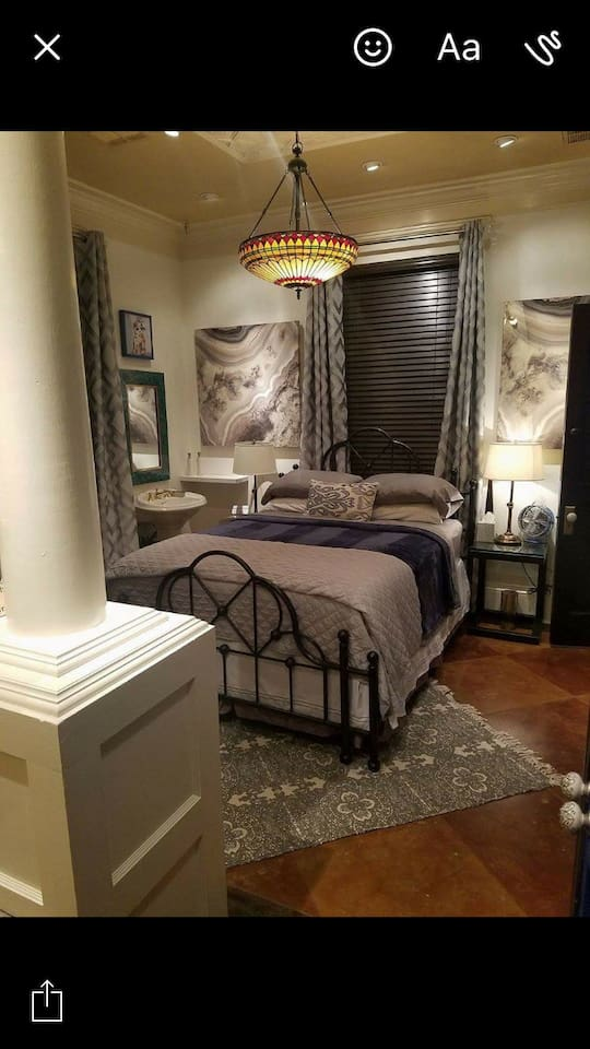 JT B&B Queen sized iron bed for two. Suite also includes his and her vanities. stocked mini frig, coffee and snacks