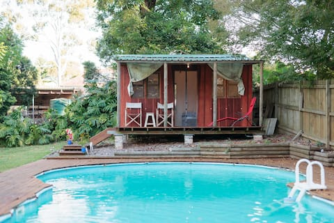 Cabin overlooking swimming pool