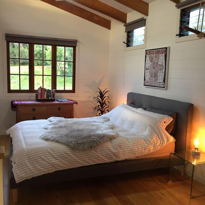 The bedroom has a new, comfy queen bed with designer linen, and a modern en suite bathroom