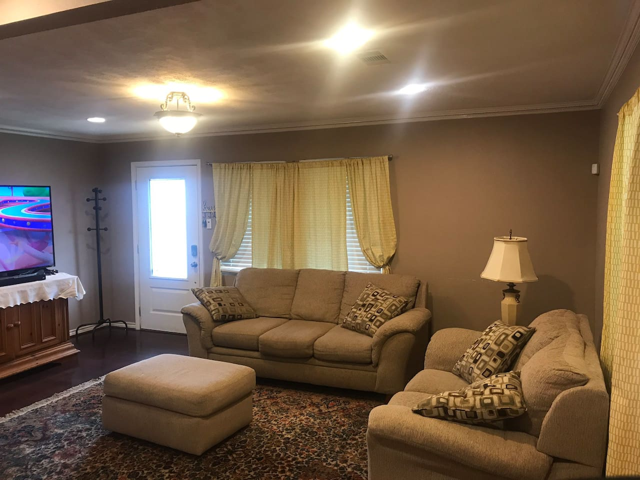 Living area with 2 sofas with an end table and an ottomon. Cable TV available through DIRECTV NOW via Amazon Firestick.