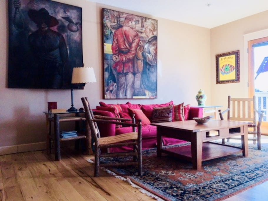 Living Room ready to relax and enjoy the mountains and the miracle of rest in front of painting by Chuck Walker and Robert Blodgett
