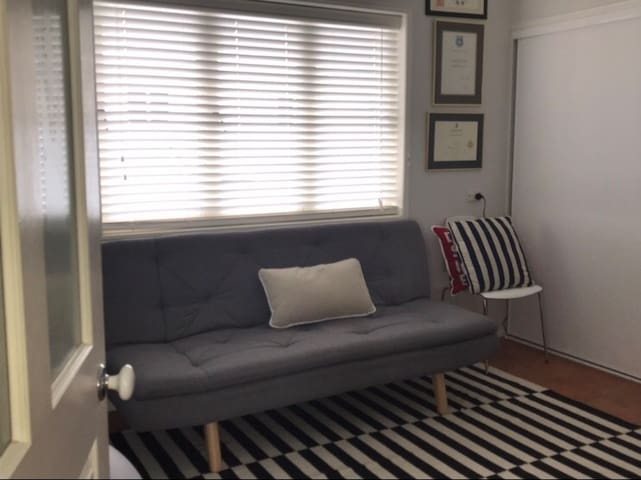 Upstairs library/ spare room with futon style fold out bed (small double)
