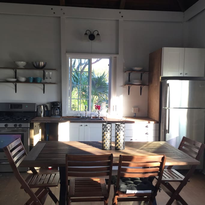 Kitchen showing inside dining area