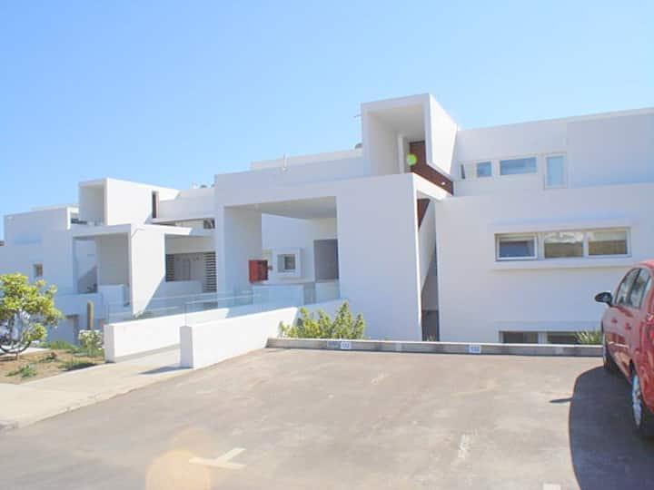 Modern, in exclusive beach resort
