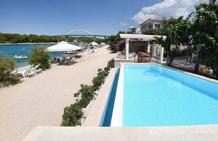 Holiday house ''Bruno'' - beachfront with pool