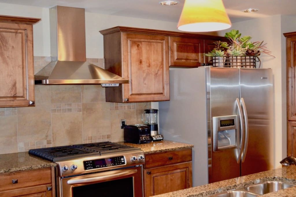 Kitchen with stainless steel appliances and knotty alder cabinets