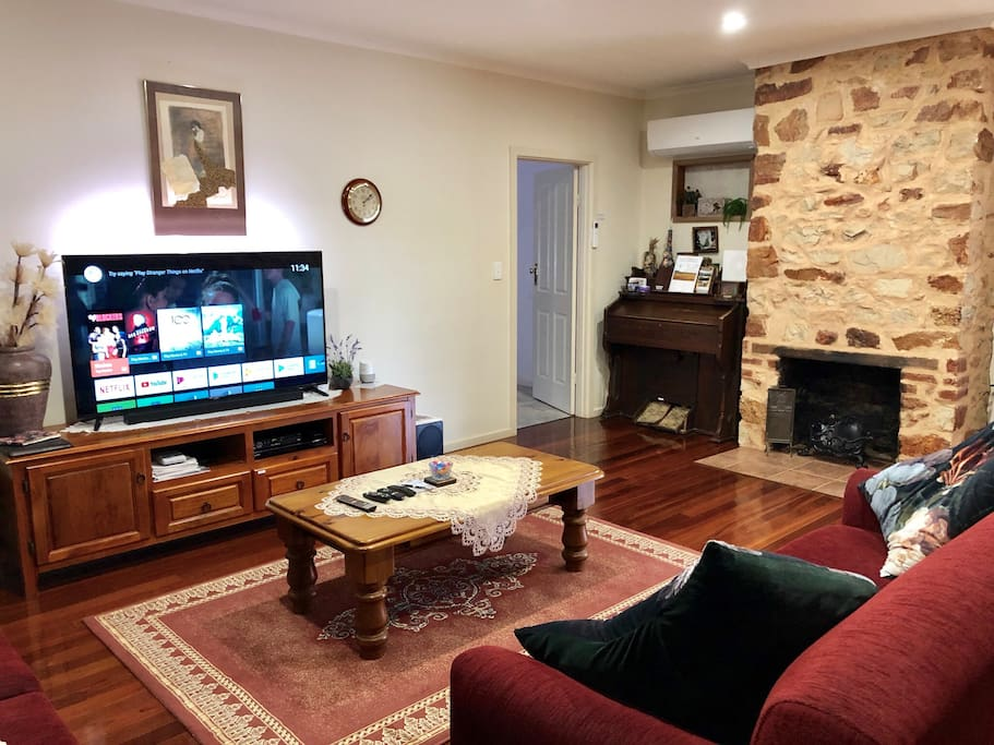 """Lounge Room, heated and Airconditioned.  58"""" voice-controlled Tv, Netflix and over two dozen premium Foxtel channels Jukebox plus google home"""