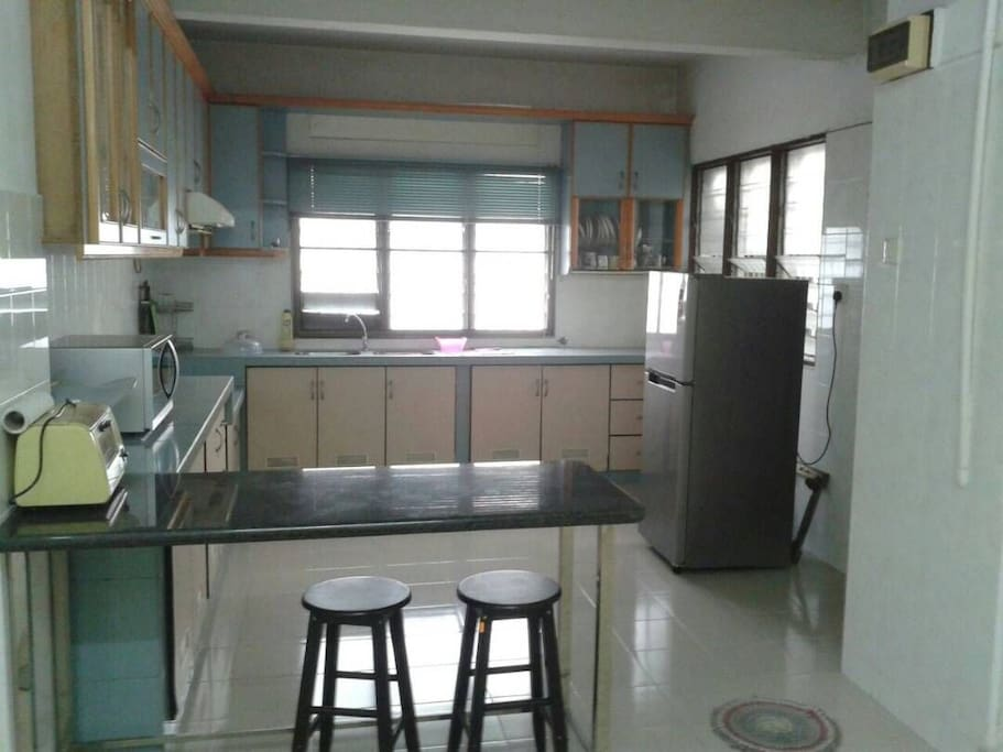 Kitchen with Refrigerator, Microwave, Oven Toaster & Cooking Hood