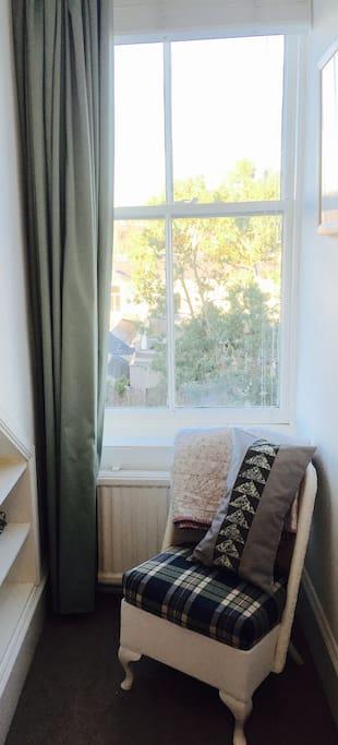 Bedroom window overlooks the garden and neighbouring rooftops.