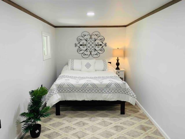 3rd bedroom with dresser in room.