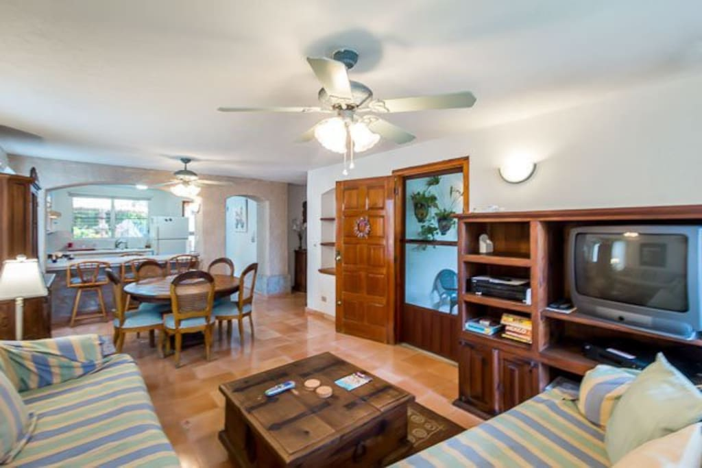 The living room offers plenty of seating and homey touches