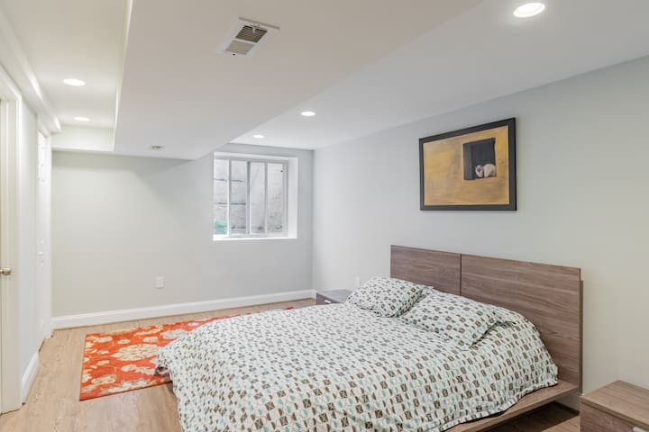 Spacious bedroom in a Bethesda home with a heart