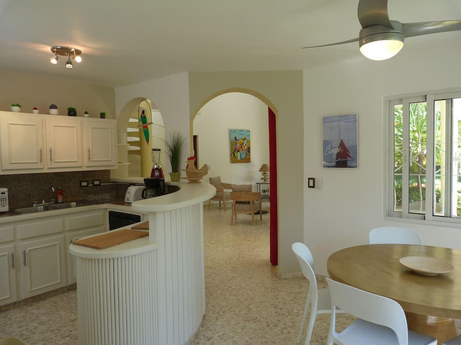 Entrance with kitchen & dining room